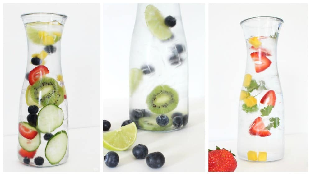 Fruit Infused Water in glass bottles, strawberries cilantro mango, blueberry lime kiwi.