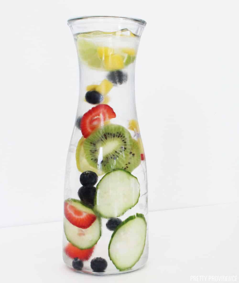 Strawberries, kiwi, cucumber, blueberries and mango in cold water, fruit infused water recipe.