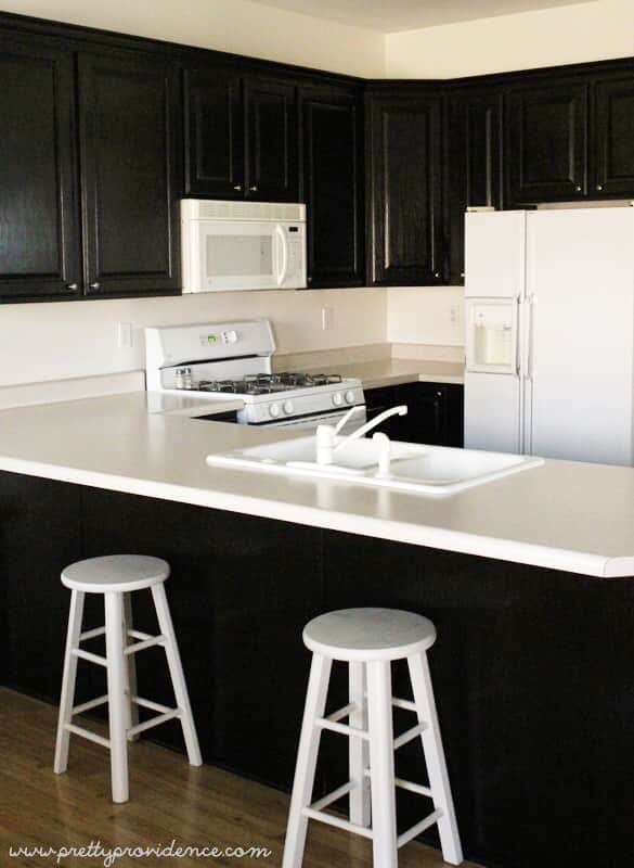 She stained all the cabinets in her entire house for under $200! AMAZING!!!
