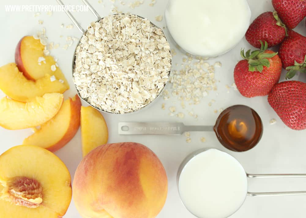 ingredients for a strawberry peach smoothie artfully arrayed on a granite countertop