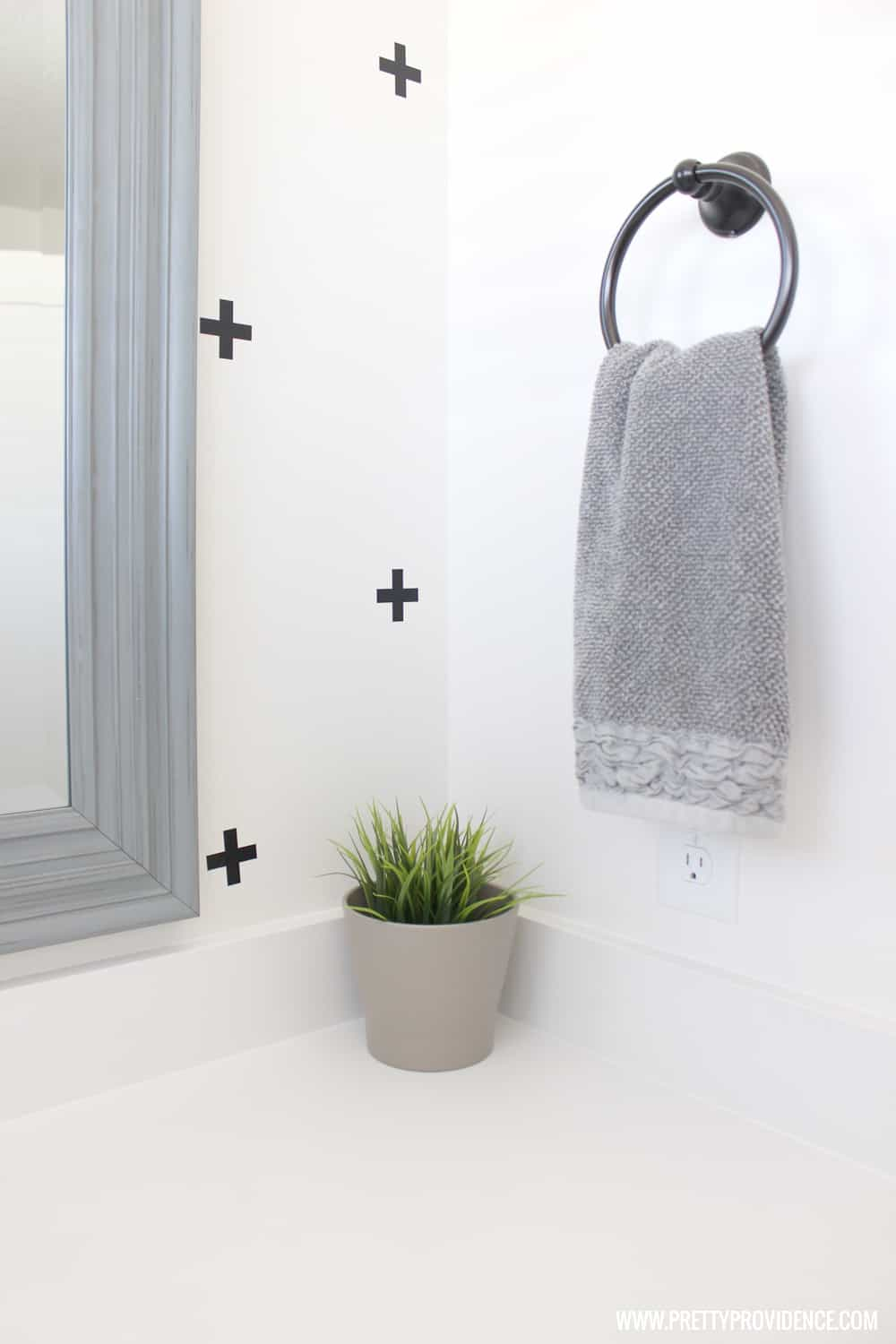 A super fun and easy boys bathroom makeover! on a budget! I can't believe how easy those wall decals were to apply!