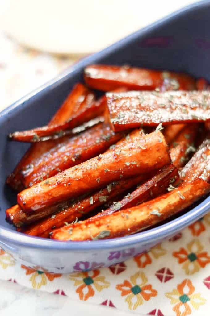 Brown Sugar Balsamic Roasted Carrots close up in a blue dish.