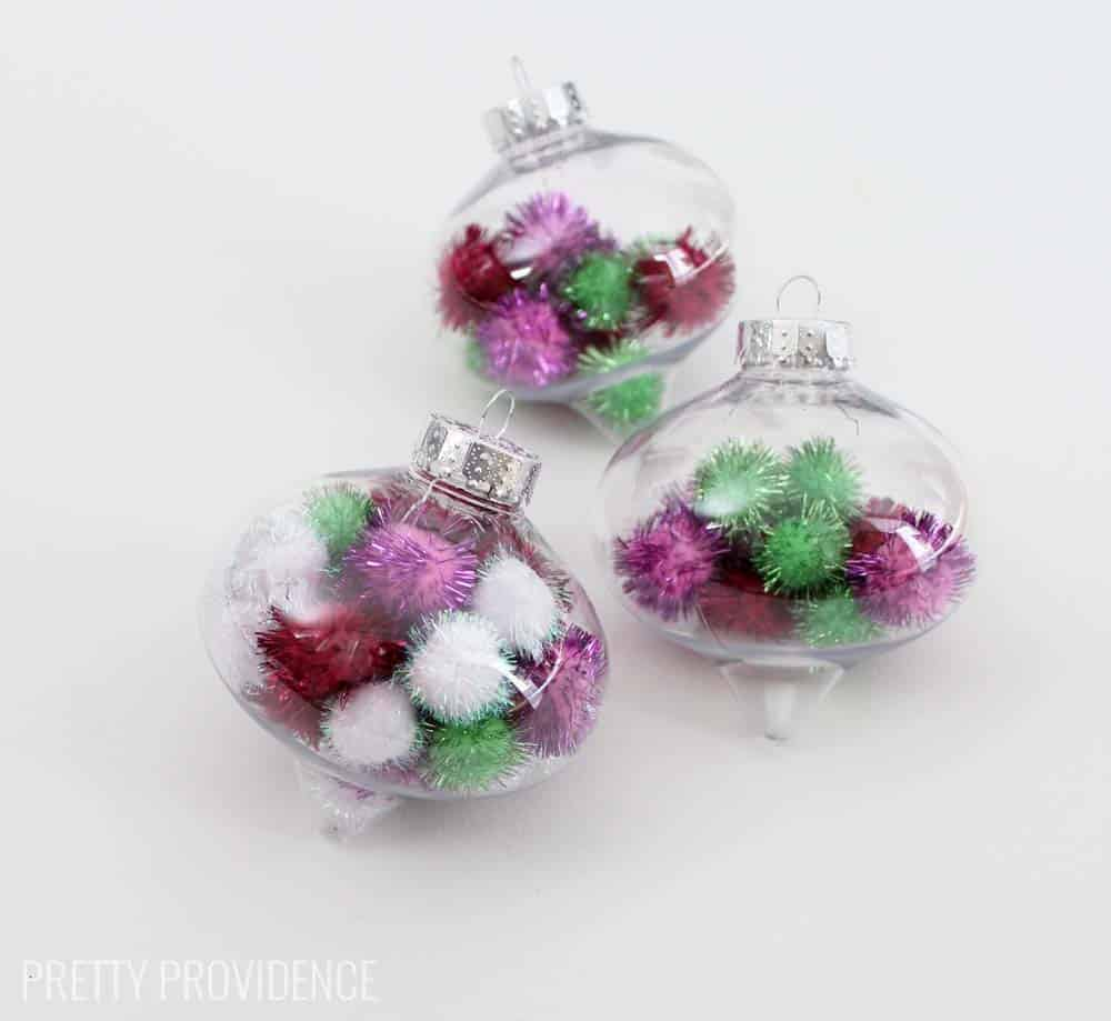 Totally doing this!!! Fun and easy DIY pom pom ornament. I LOVE these and you can use whatever colors of pom poms you want!!