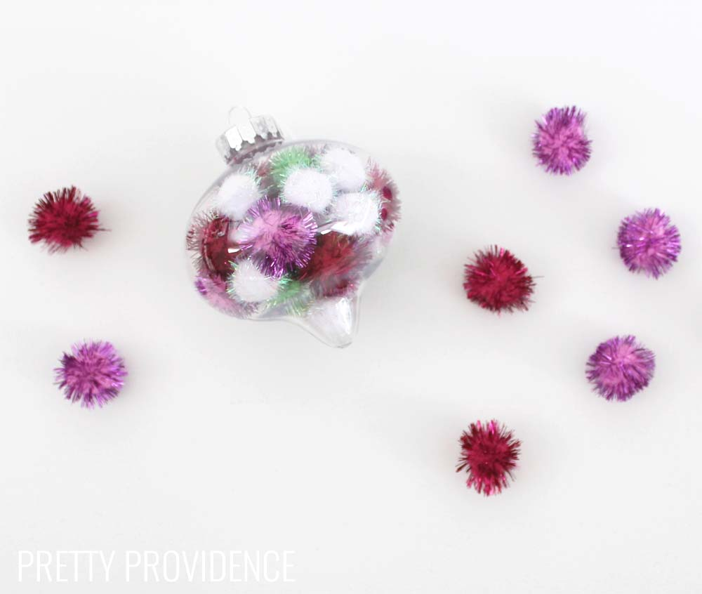 Totally doing this!!! Fun and easy DIY ornament. I LOVE these and you can use whatever colors of pom poms you want!!