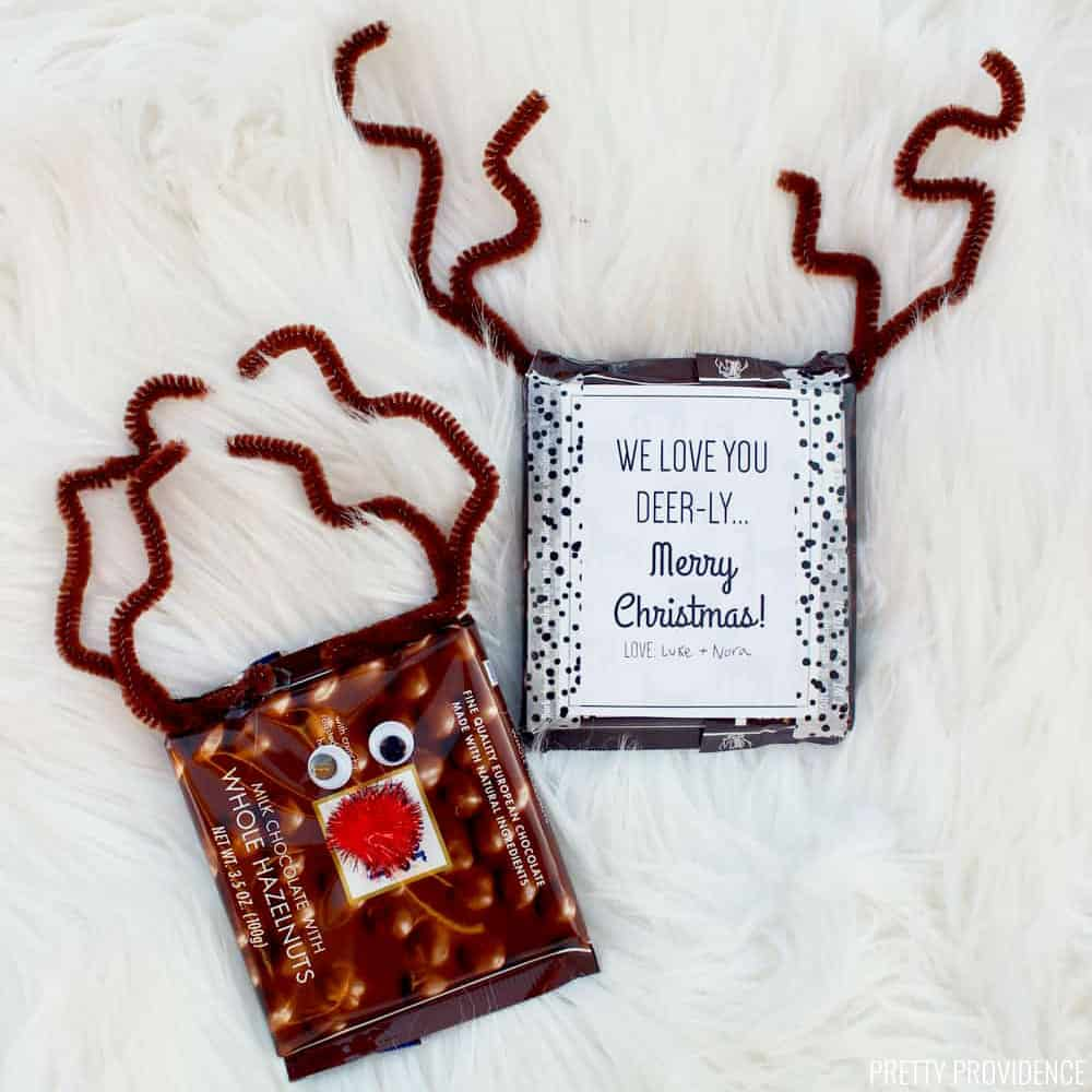 Reindeer candy bar with googly eyes, a red pom pom nose and pipe cleaner antlers.