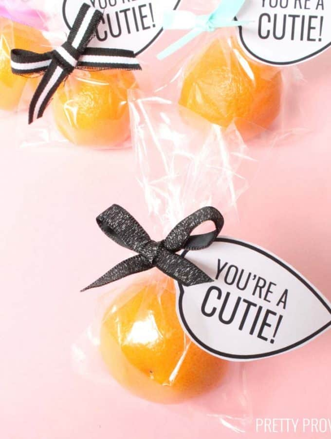 You're a Cutie Valentine printable leaf tag tied onto a small mandarin orange in a clear bag.