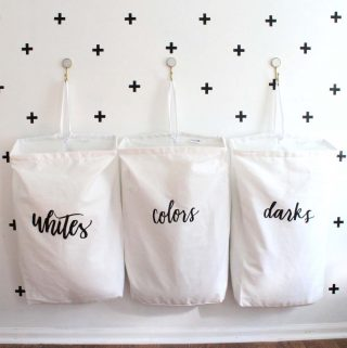 I love this space-saving laundry organization idea! The bag labels are so pretty too!