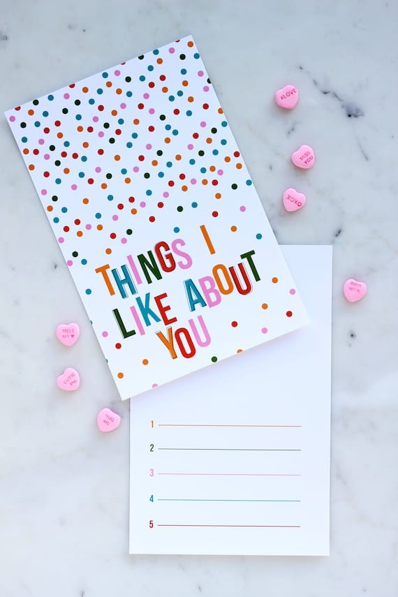 """Valentine Printable with colorful confetti with text that reads """"Things I like About You"""" with numbered lines inside of it."""