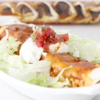 Okay these beef enchiladas are so easy! Just through the stuff in the crockpot in the morning then all you have to do is scoop some of the meat mixture, add the cheese, roll up and bake a few minutes! SO easy and SO delicious! A family favorite for sure!