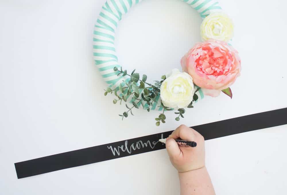 This easy spring wreath is easy to make with ribbon, faux flowers and a little bit of fun!