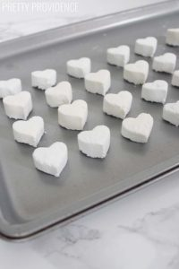 heart shaped toilet bombs on a baking sheet