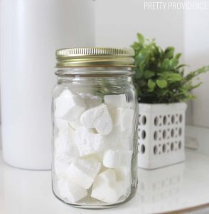 heart shaped toilet bombs in a mason jar on a bathroom counter