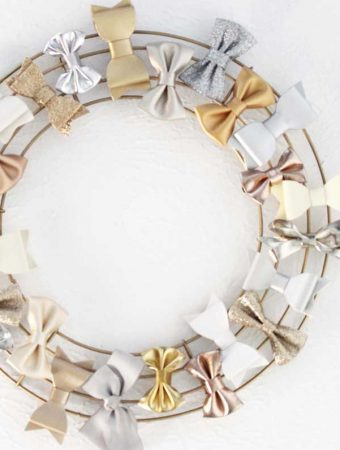 Hair bow organizer from a wire wreath form! Such an easy way to keep track of girls' hair bows!
