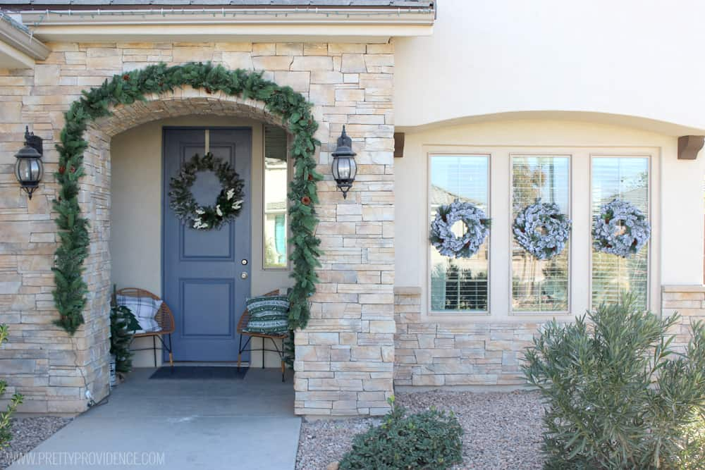 I am loving the color scheme of this beautiful Christmas front porch!