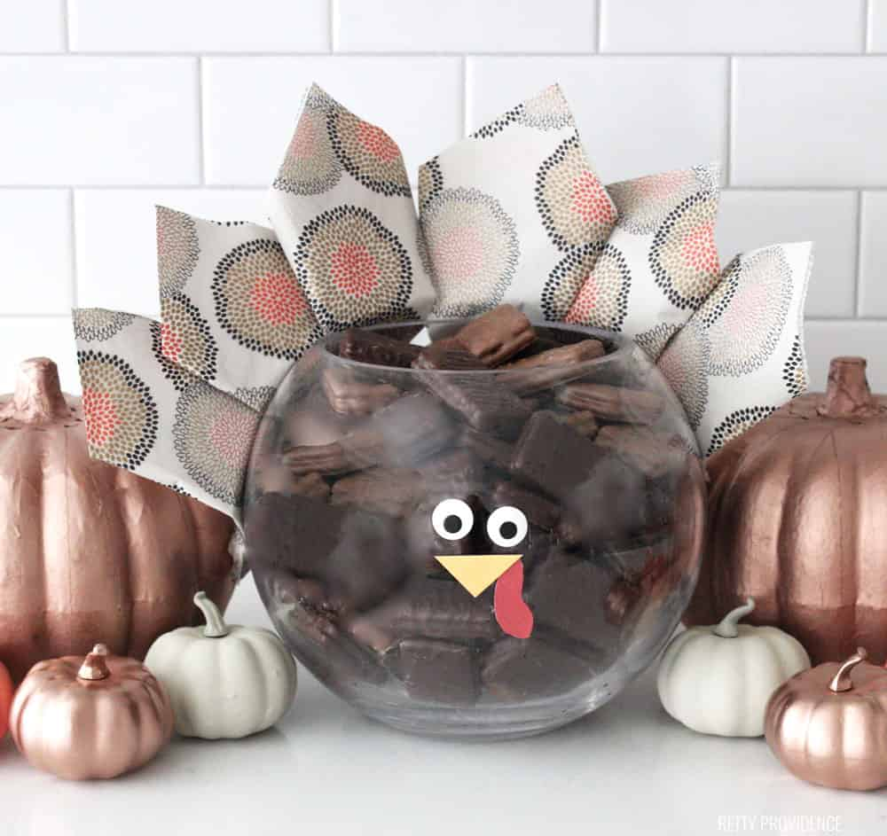 Thanksgiving Centerpiece - Glass bowl made to look like a Turkey with napkins for feathers and a face.