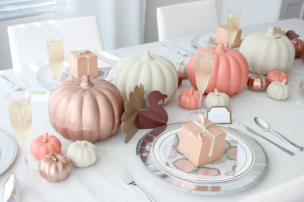 Thanksgiving Table Decorated with pumpkins in orange, cream, bronze and brown color scheme.