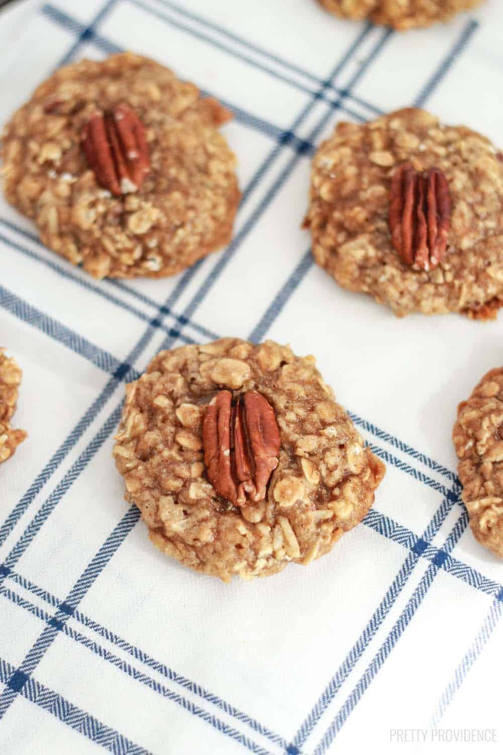 Maple oatmeal cookies with pecans in the middle of each one.