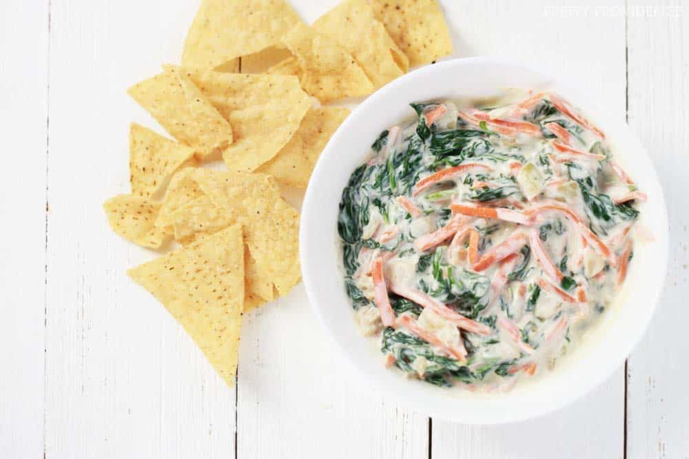 This healthy veggie dip is delicious and guilt-free! Full of spinach, onions and carrot. Perfect for regular snacking or as a lighter option for game day!