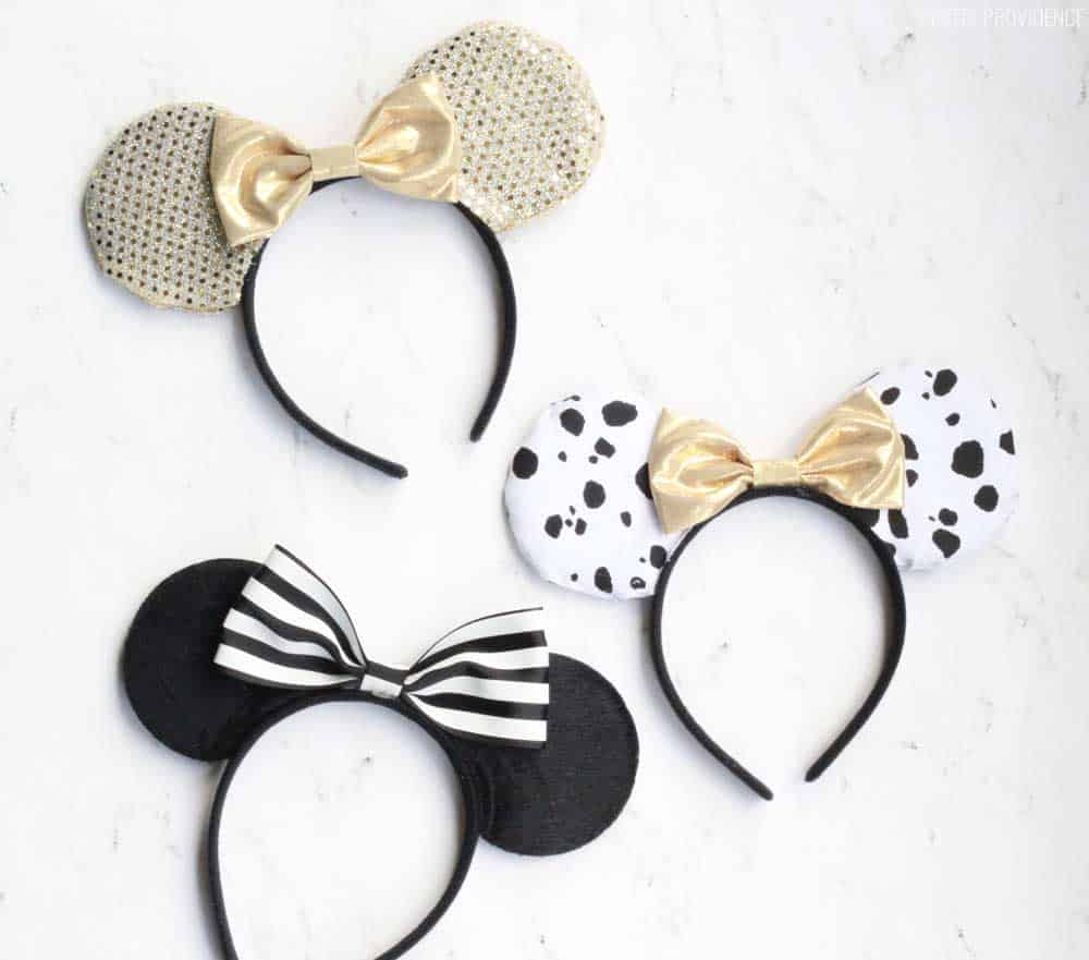 three pairs of diy no sew minnie mouse ears on a white counter