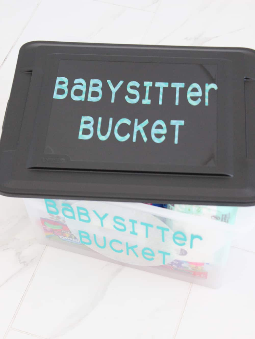 Babysitter bucket filled with all the essentials a baby sitter will need to care for your kids, plus fun toys and games!