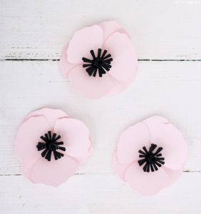 Pink paper flowers made with Cricut