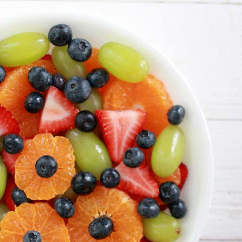 Easy fruit salad recipe with sweet vanilla pudding mix dressing.