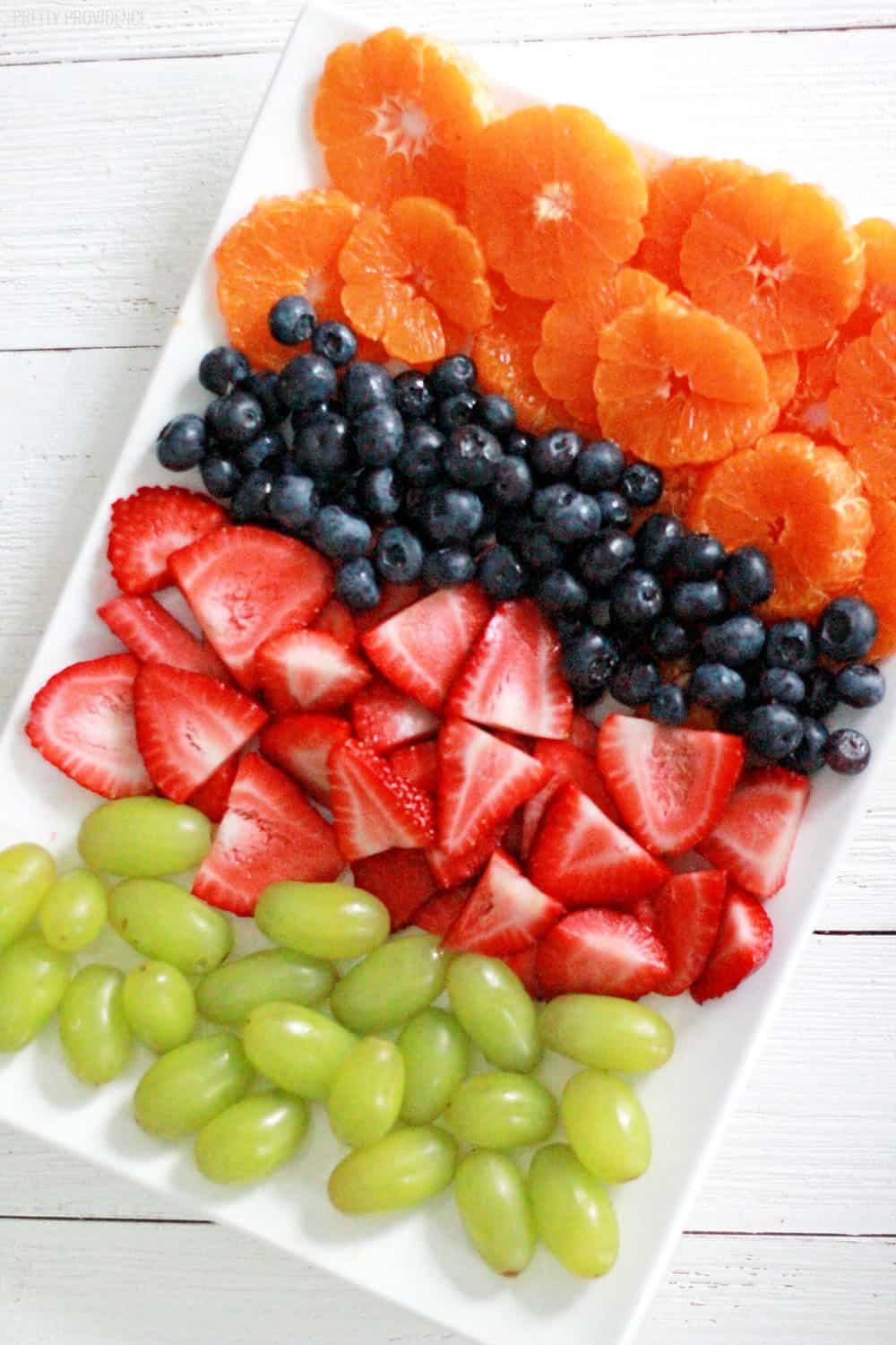 Colorful fruit salad - strawberries, blueberries, green grapes and oranges!