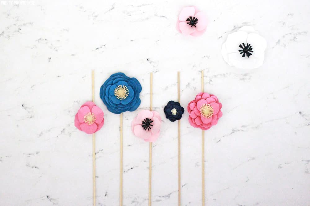How to make a Cake Topper with paper flowers and skewers! This is an awesome, easy cake decorating idea!