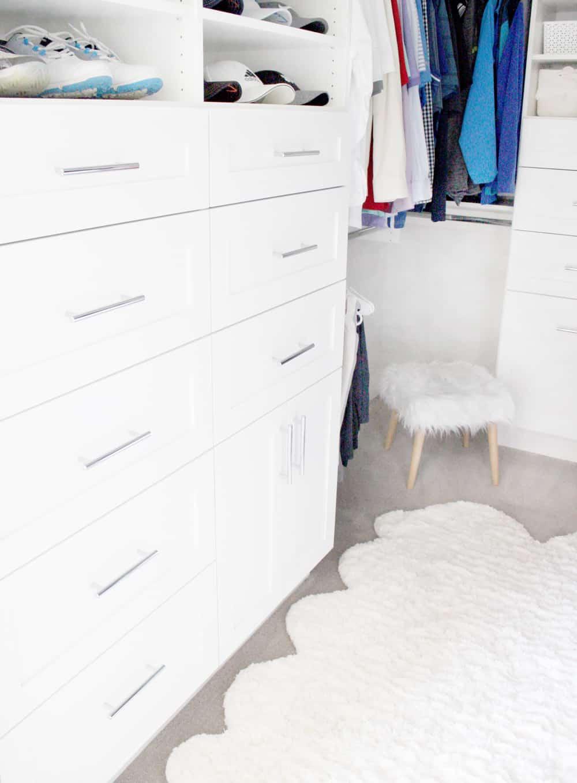 Master closet drawers. Master closet rug. Master closet stool.