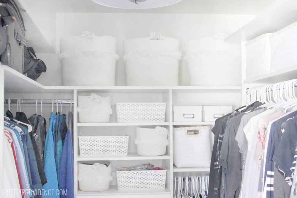 Master closet storage baskets and bins. Master closet shelving. Master closet built in hamper.