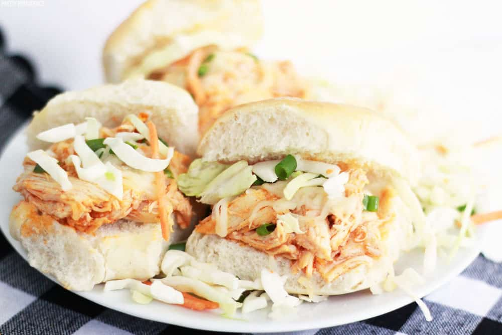 These easy buffalo chicken sliders with coleslaw and green onions.