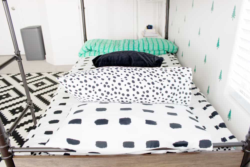 Beddy's bedding and throw blanket on bunkbeds!