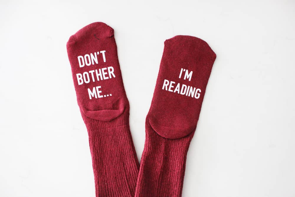"""Don't bother me, I'm reading"" funny socks"