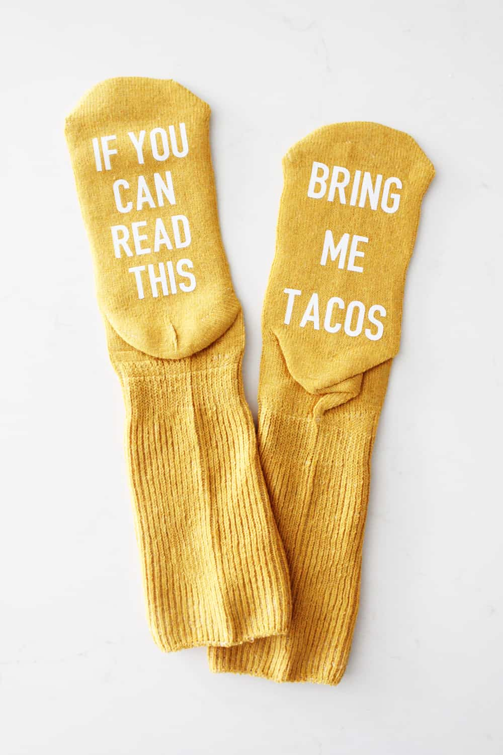 """If you can read this, bring me tacos"" funny socks"