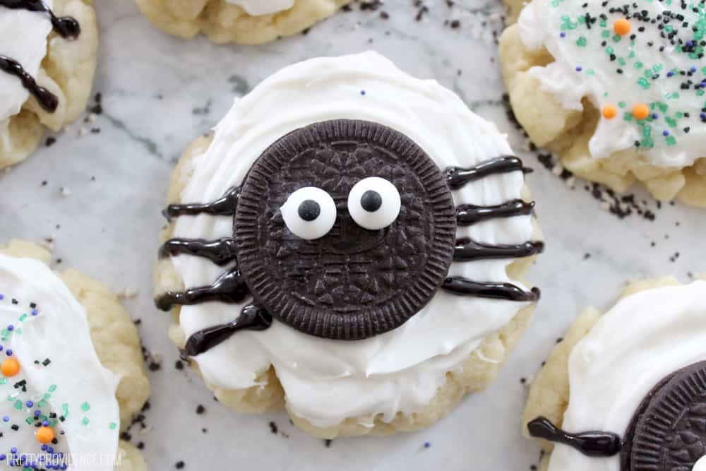 sugar cookie with oreo spider on top on a granite counter