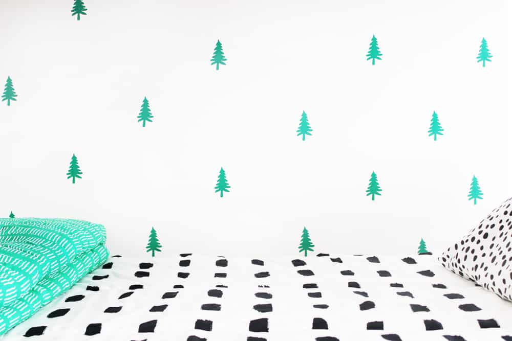 How cute is this DIY tree wall? Guess what? It took less than two hours and less than $20 to make! Oh, and it's removable!