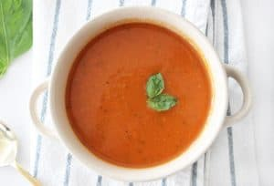 Hearty and delicious dairy free tomato soup! Not only is this soup super healthy, but it is so dang good! Your kids will never know it's packed full of veggies!