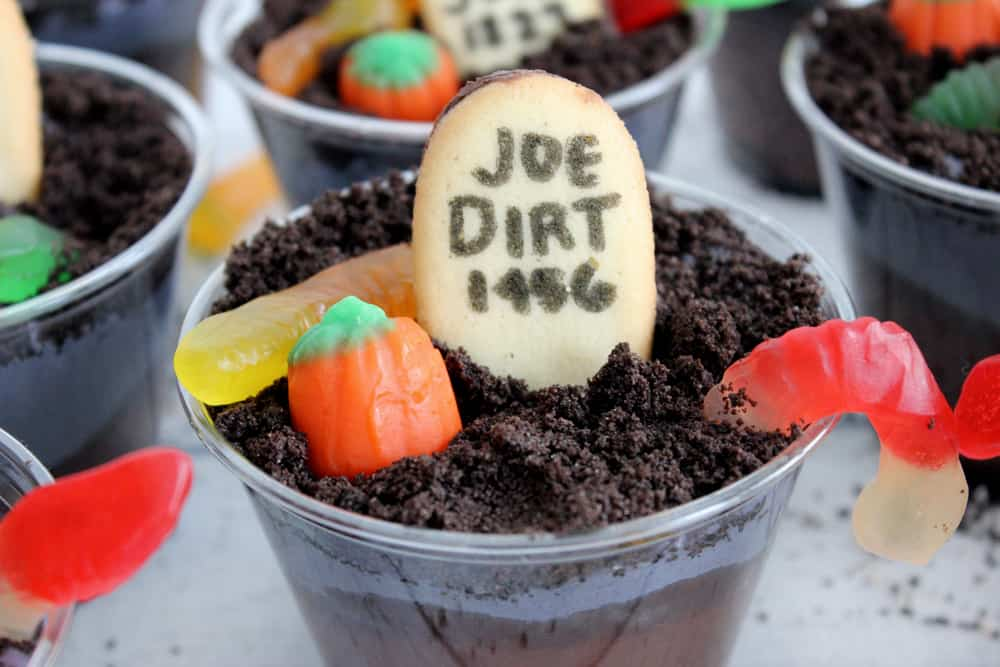 How dang cute are these easy Halloween Dirt Cups?! The grey layer has a secret ingredient that makes these taste BEYOND amazing!