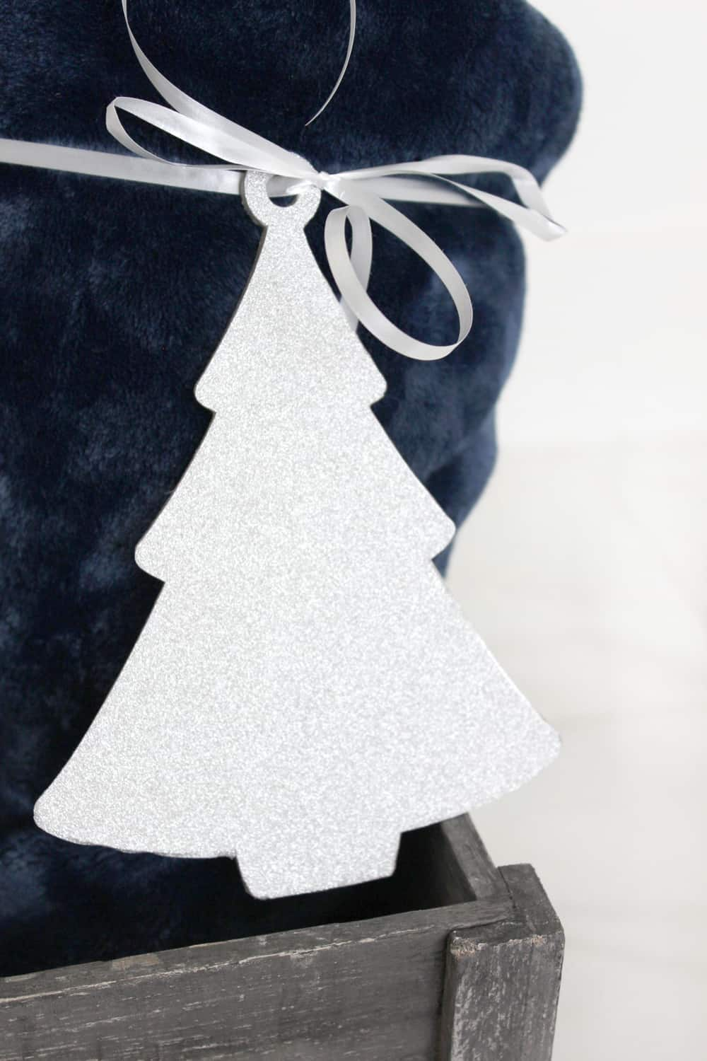 Adorable DIY ornament made from chipboard and glitter vinyl.