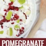 Apple Pomegranate Salad in a white bowl. Pomegranate recipe with pomegranate seeds on top.