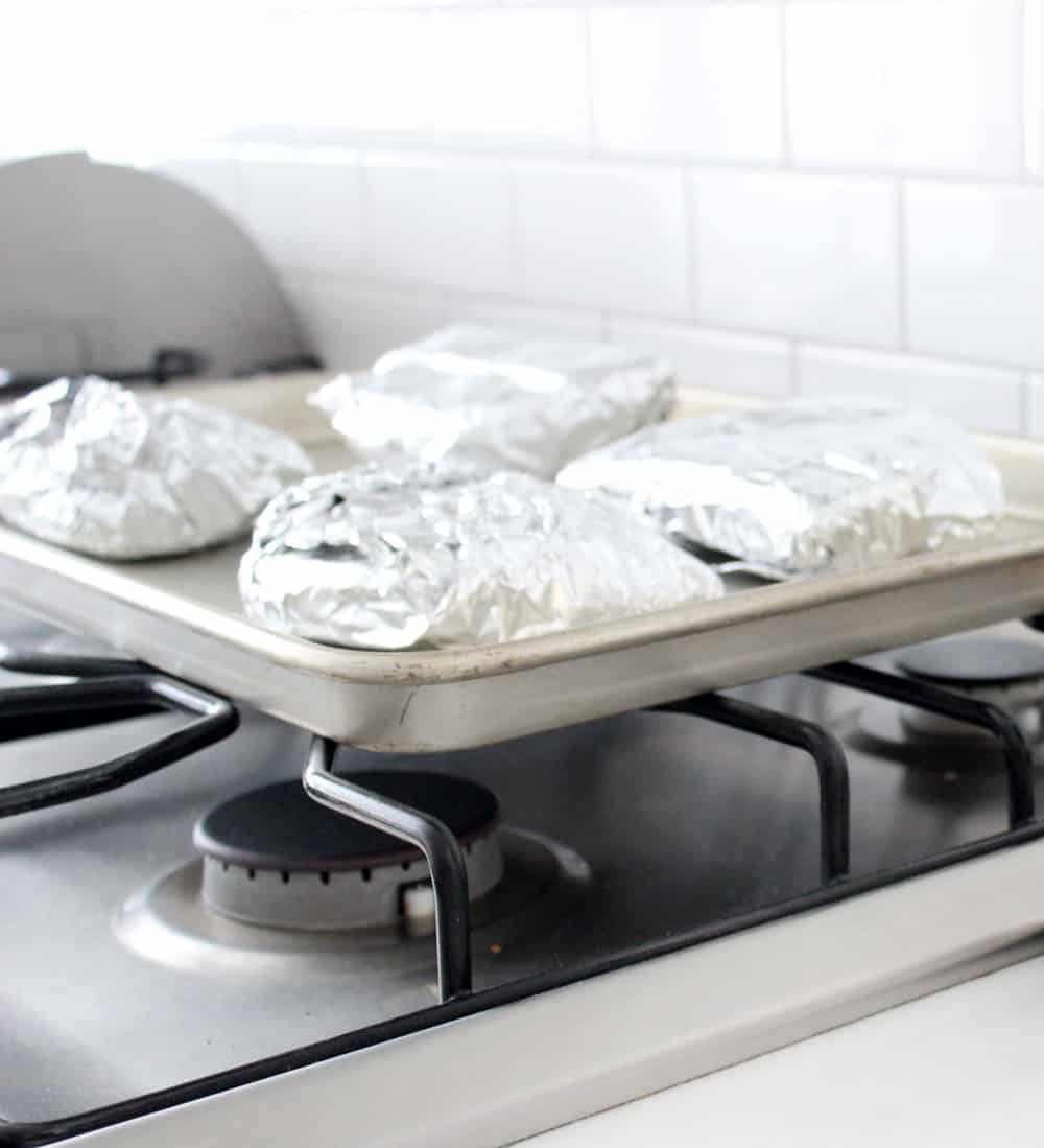 Michael Angelo's calzones wrapped in foil, about to go in the oven.