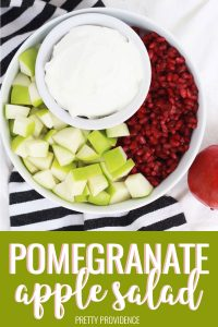 Apple Pomegranate Salad ingredients, cubed granny smith apples, pomegranate seeds, cool whip in a bowl.
