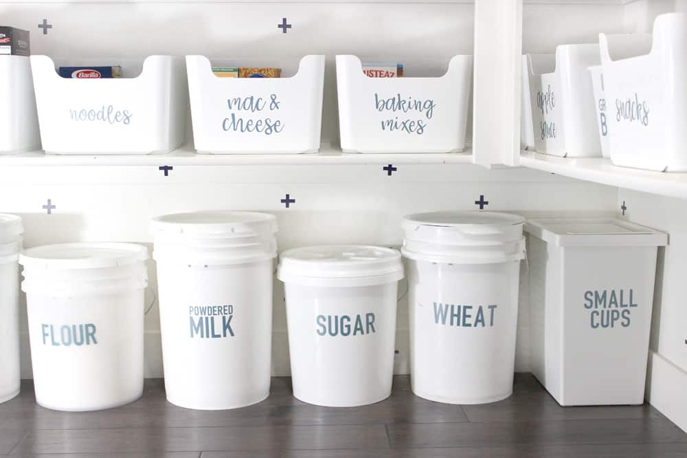 labeled five gallon jars in pantry