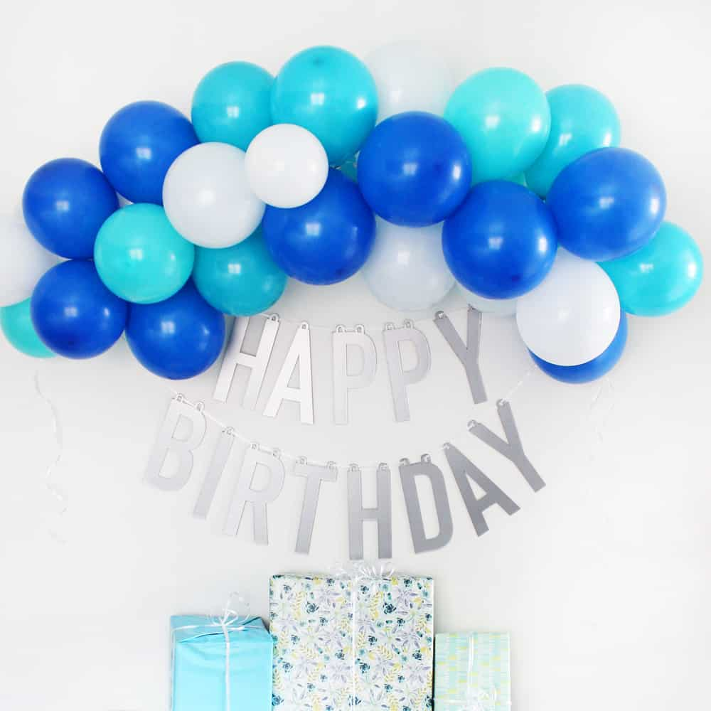 If you want a happy birthday banner that you can use over and over again you will love this happy birthday banner DIY made using the Cricut knife blade and chipboard! I can't wait to use this for all my kids birthdays for years to come.