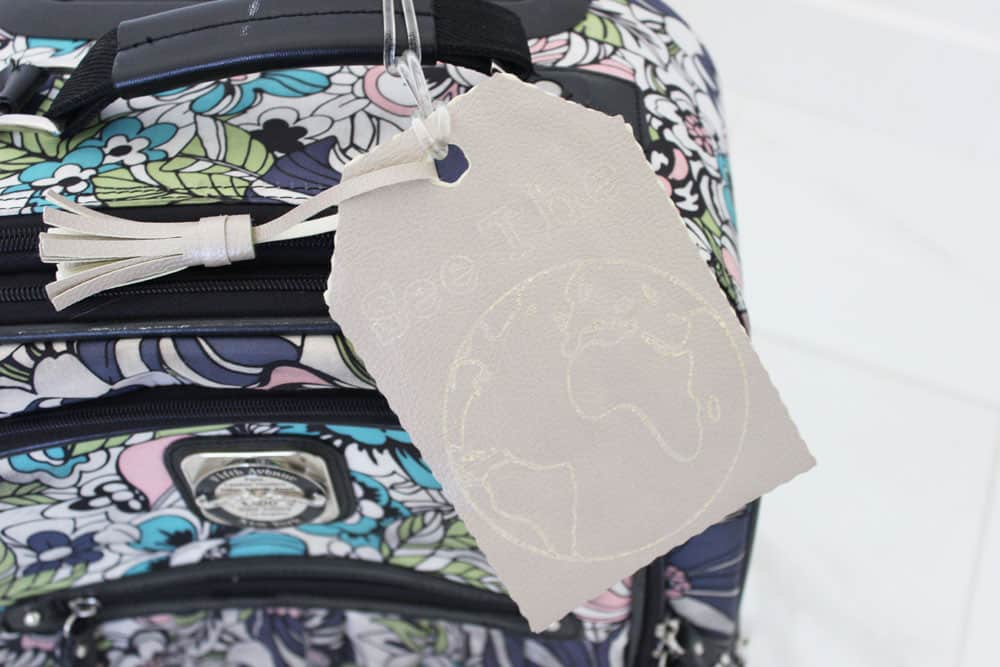 diy luggage tag on a cute floral carryon bag
