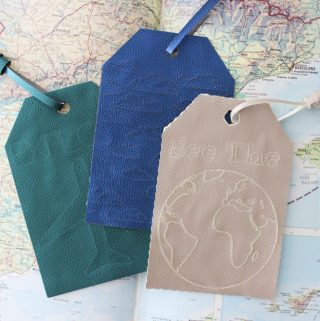 diy luggage tags on top of an open atlas