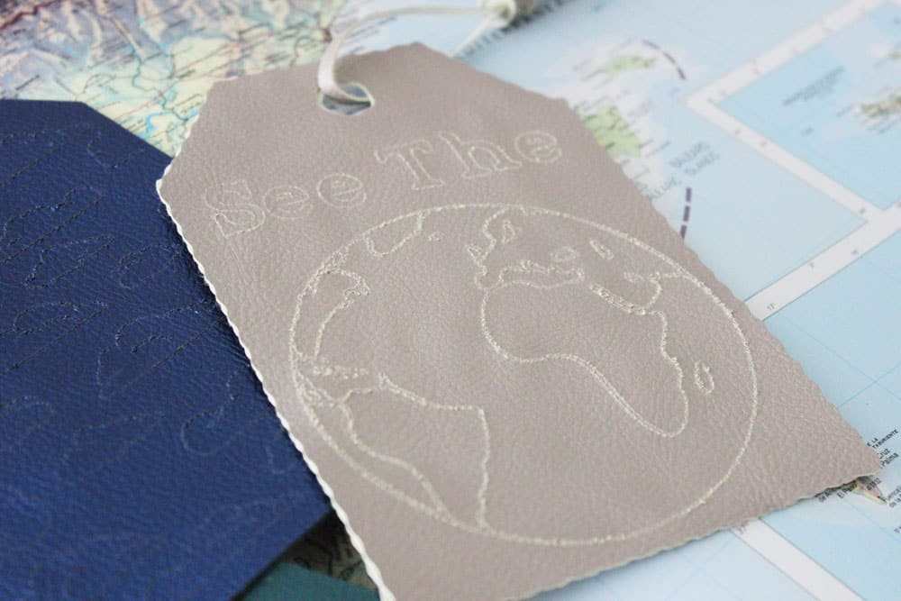 see the world engraved faux leather keychain