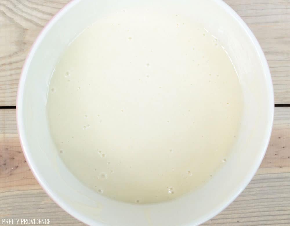 White cake batter in a mixing bowl.