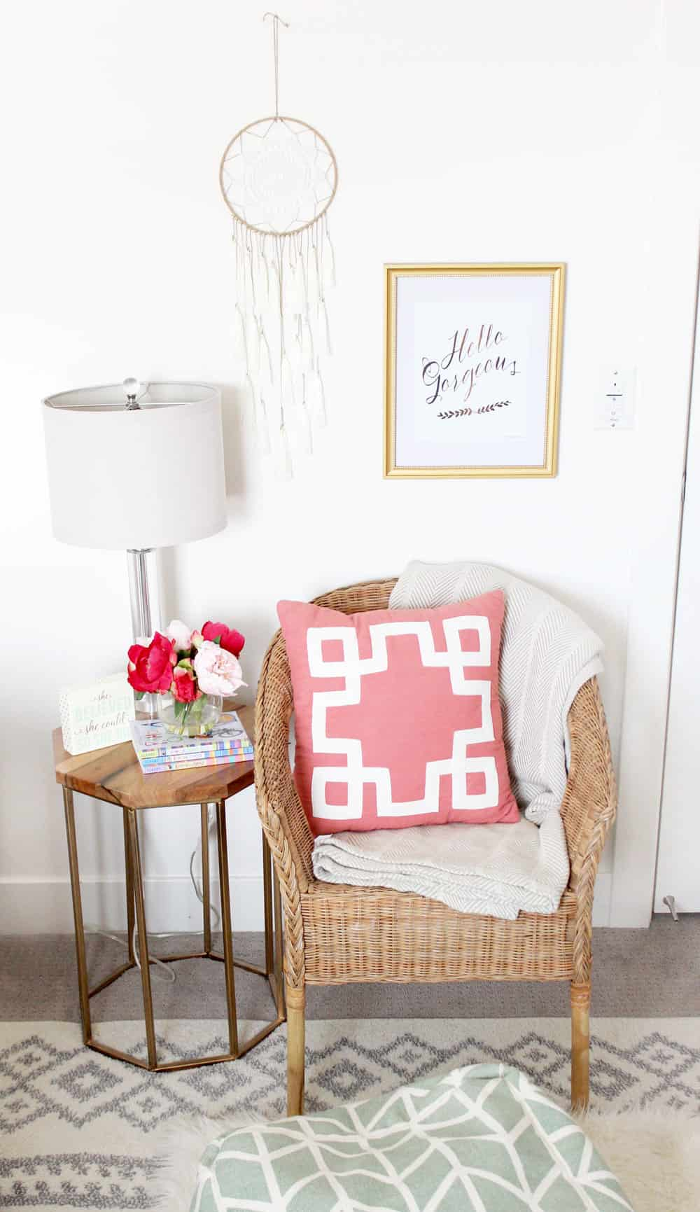 cute wicker chair and metal wood topped side table in a girls bedroom
