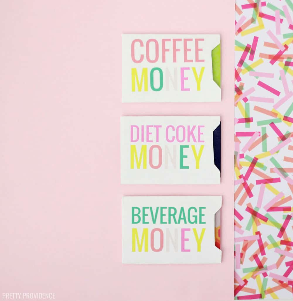 White card envelopes folded with gift cards in them, 'Coffee money' 'Diet Coke Money and 'Beverage Money' in colorful letters on a pink background with confetti.